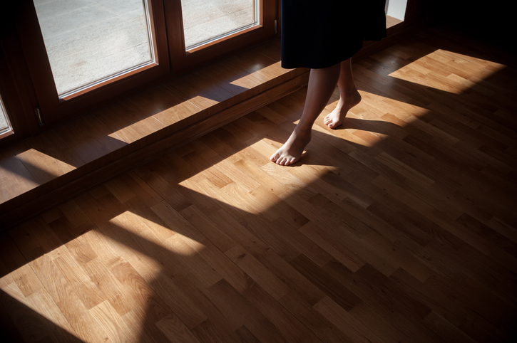 Woman walks on squeaky wood floor
