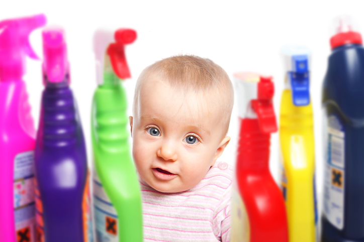 Little child wants to play with chemical cleaning products