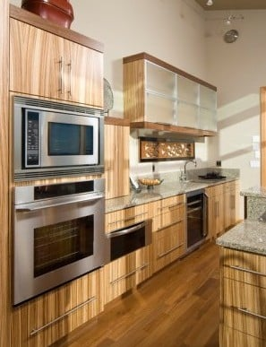 Modern kitchen with bamboo cabinets and granite counter tops