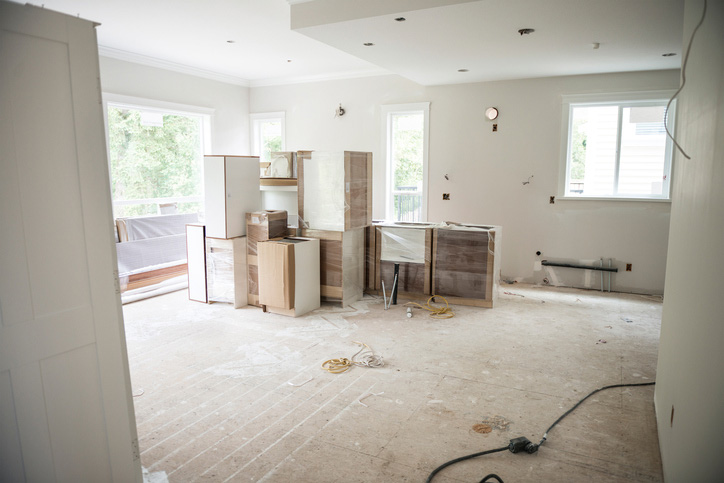 home under construction with sub flooring in kitchen exposed