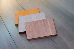 three tongue and groove bamboo flooring samples laid on top of bamboo flooring planks