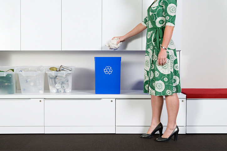 Woman recycling in office