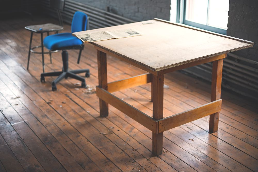 photo of rectangular brown wooden desk on bamboo floor