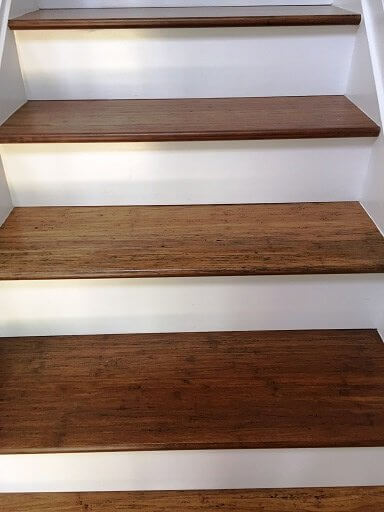 CUSTOM STAIR TREADS BY AMBIENT ANTIQUED CARBONIZED BAMBOO TREADS