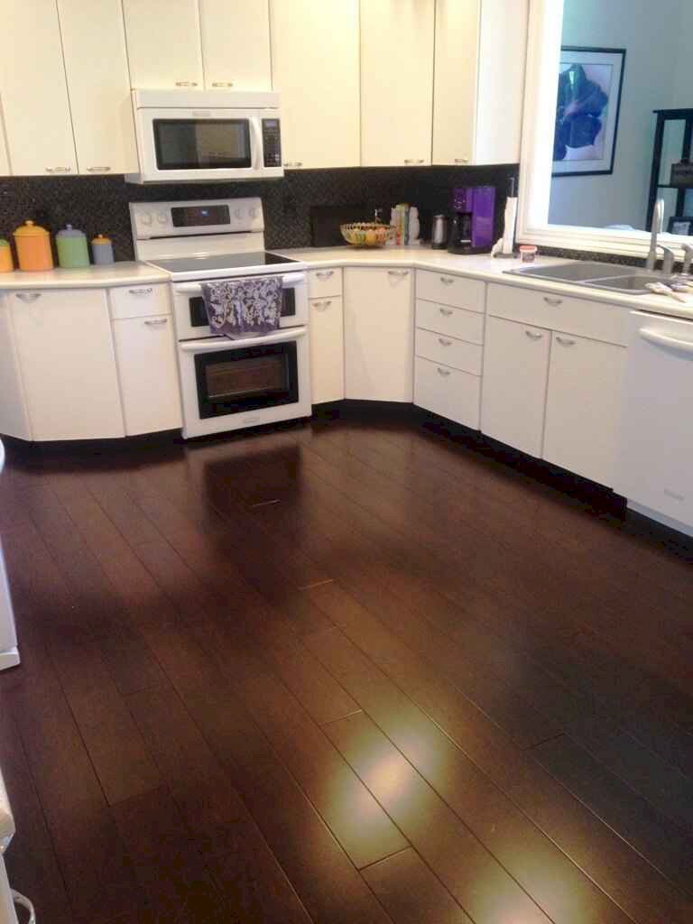 dark-flooring-contrasted-kitchen-cabinets