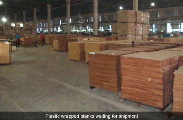 plastic wrapped planks waiting for shipment